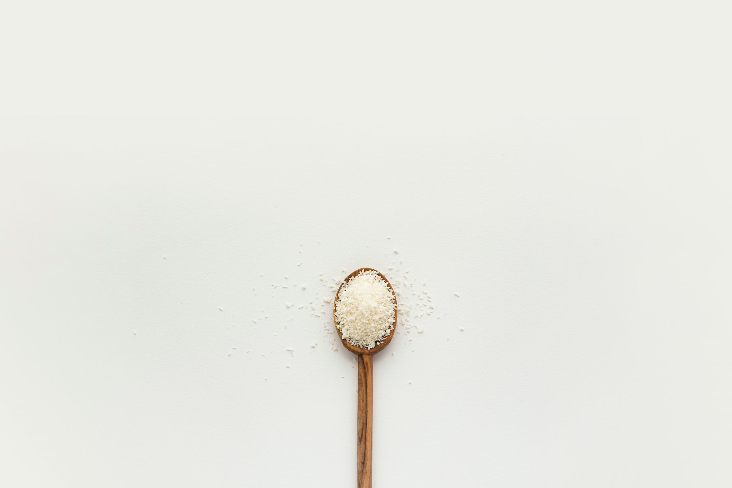 A wooden spoon full of Ferric Sulfate